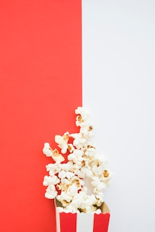 Cinema concept with popcorn background