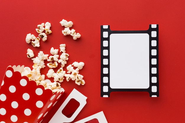 Cinema elements on red background