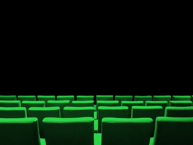 Cinema movie theatre with green seats rows and a black copy space background