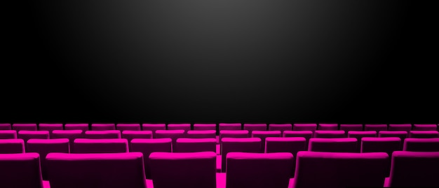 분홍색 좌석 행과 검은 색 복사 공간 표면이있는 시네마 영화관