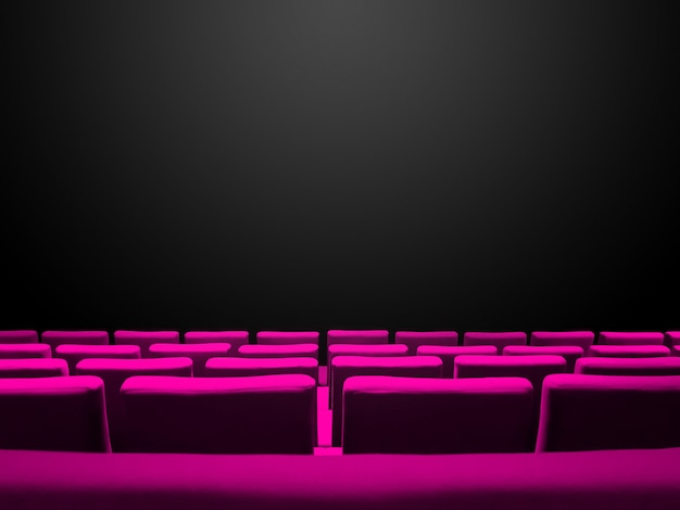Cinema movie theatre with pink seats rows and a black copy space background