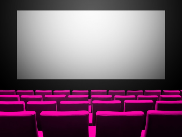 Cinema movie theatre with pink velvet seats and a blank white screen. copy space background