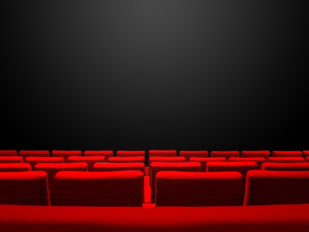 Cinema movie theatre with red seats rows and a black copy space background