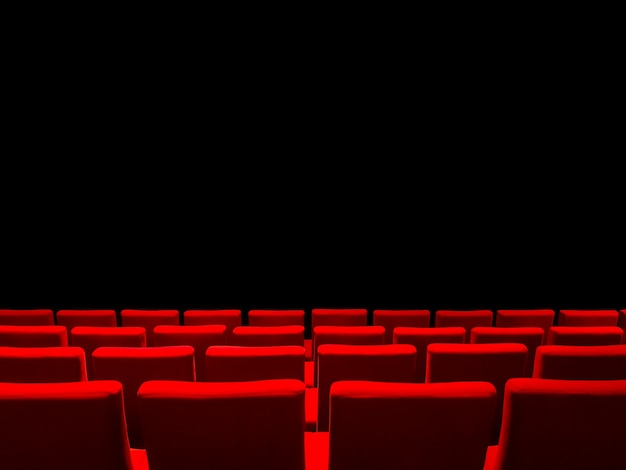 Cinema movie theatre with red seats rows and a black