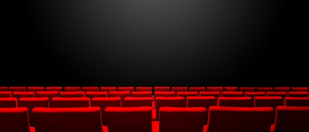 Cinema movie theatre with red seats rows