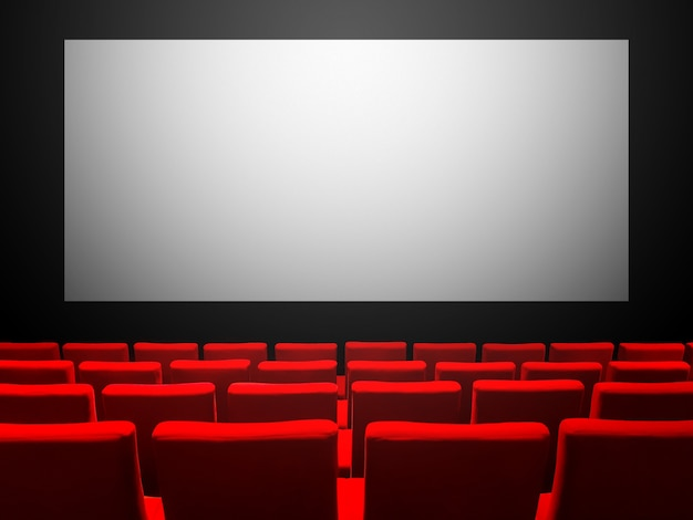 Cinema movie theatre with red velvet seats and a blank white screen