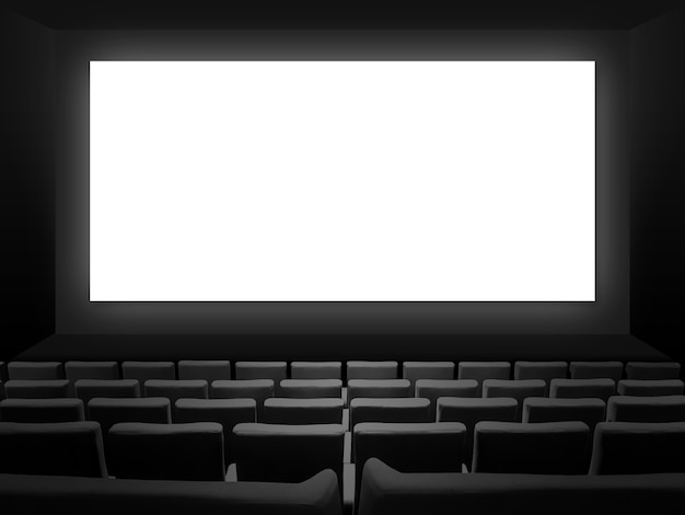 Cinema movie theatre with velvet seats and a blank white screen. copy space background