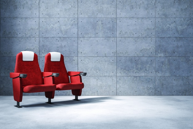 Cinema seat and copy space , concrete wall  background