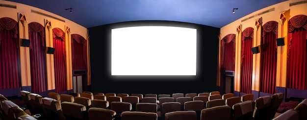 Cinema theater showing empty white movie screen.