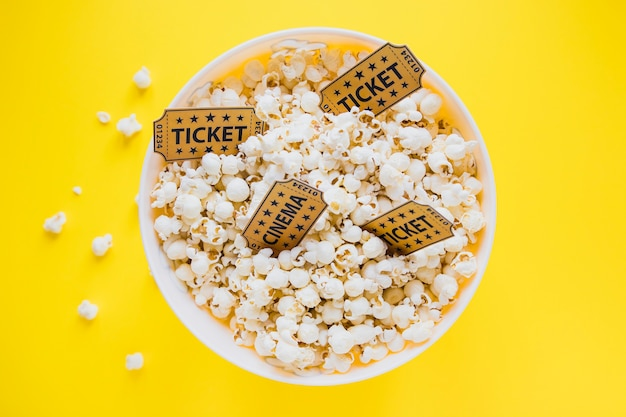 Cinema tickets in bucket with popcorn