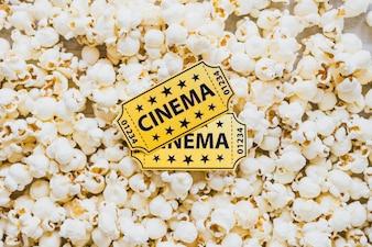 Cinema tickets on crispy popcorn