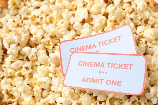 Cinema tickets on popcorn background