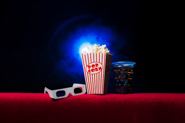 Cinema with popcorn box and 3d glasses