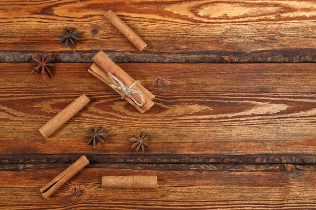 Cinnamon on dark wooden background with space for text