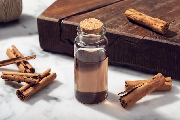 Cinnamon essential oil on marble table
