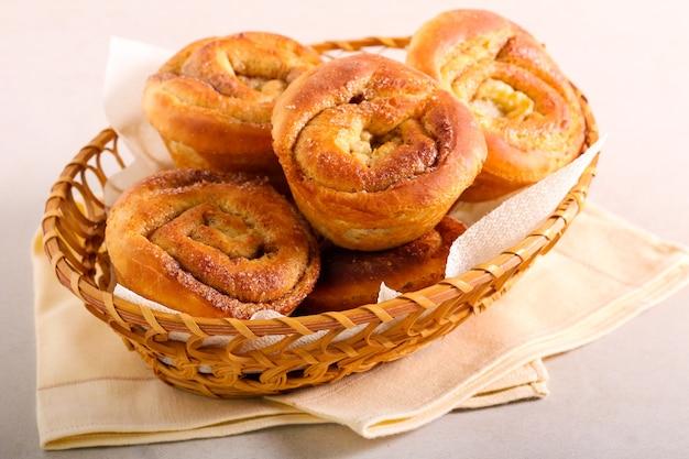 Cinnamon morning brioche buns in a basket