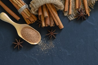 Cinnamon powder mix sugar on wood scoop