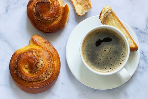 Cinnamon rolls with nut filling, served with coffee.