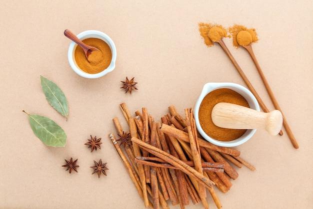 Cinnamon stick and cinnamon powder  on brown background .
