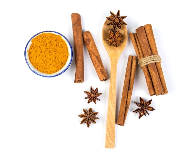 Cinnamon stick and powder with star anise spice