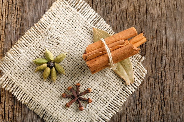 Cinnamon stick on wooden background