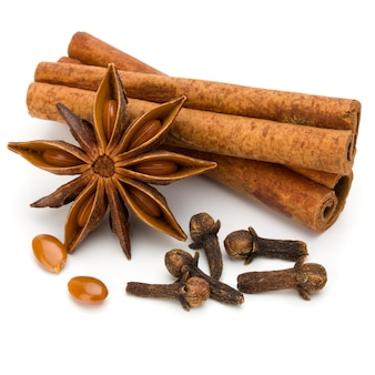 Cinnamon sticks, cloves and anise star isolated on white background close up