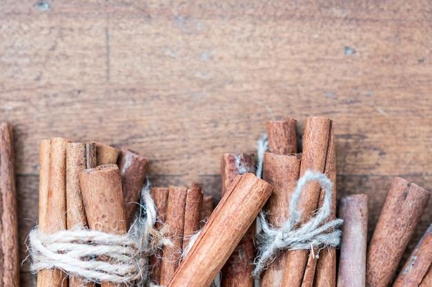 Cinnamon sticks line on wood