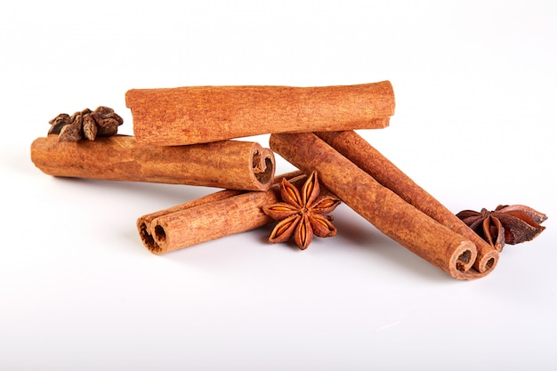 Cinnamon sticks and star anise isolated on white