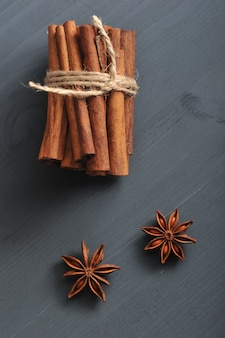 Cinnamon sticks tied with a rope and the seeds of anise