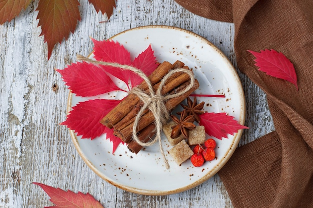 Cinnamon sticks in white plate