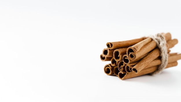 Cinnamon sticks with white copy space background
