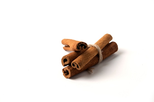 Cinnamon sticks wrapped with a rustic thread