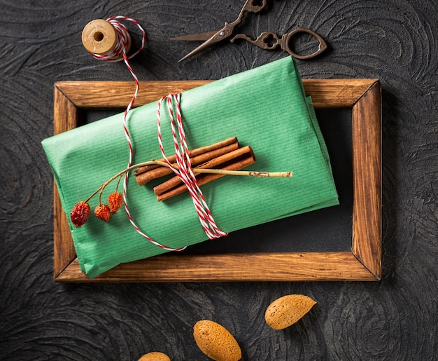Cinnamon sticks on wrapping paper