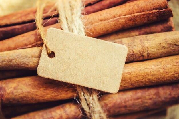 Cinnamon and tag. selective focus. food and drink.