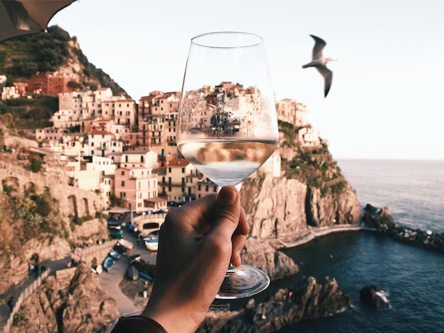 Cinque terre with a glass of wine