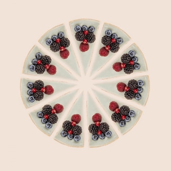 Circle of blue cheesecakes with berries