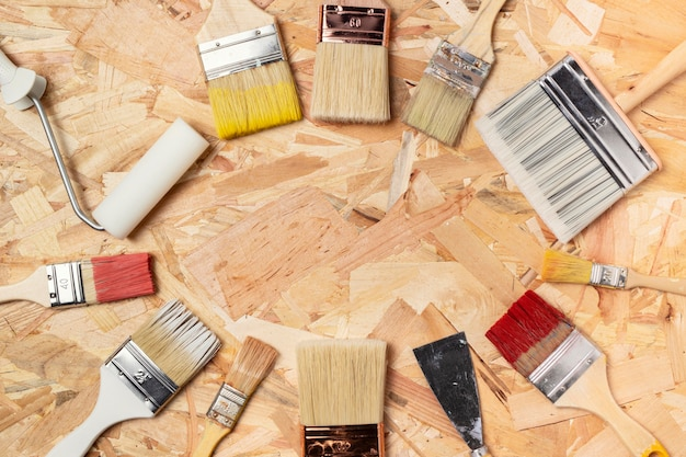 Circle of dirty paint brushes
