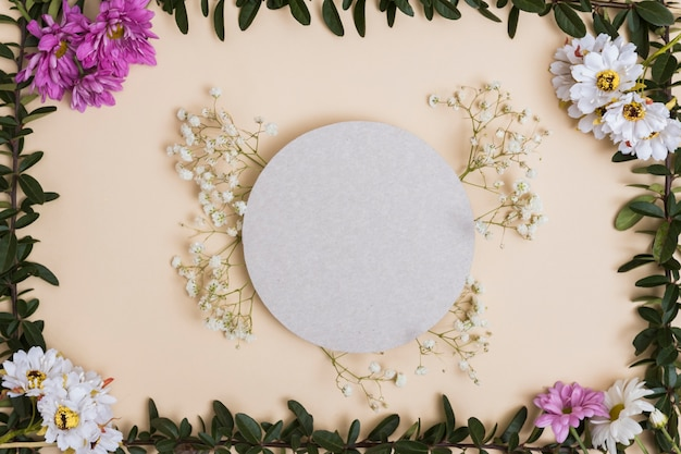 Circle and flowers composition