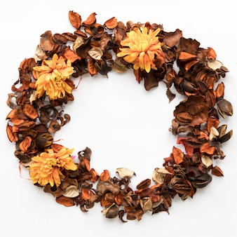 Circle from dried petals and asters
