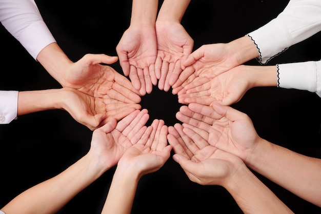 Circle of hands of people