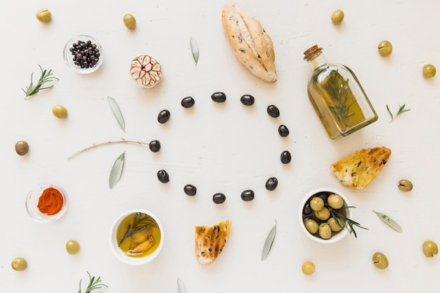 Circle of olives with bread spices and oil