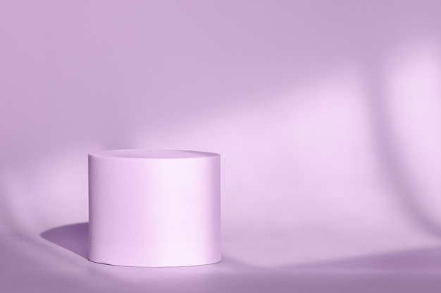 Circle platform stage for cosmetic products with geometric shadow on wall purple round pedestal