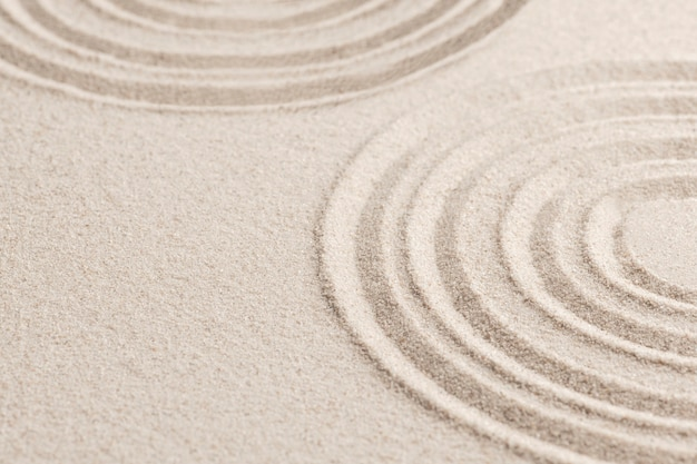 Fondo della sabbia di zen del cerchio nel concetto di consapevolezza