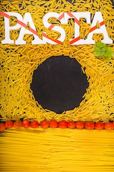 Circular black frame surrounded by pasta