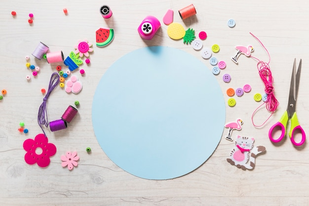 Circular blue blank paper with decorative elements on textured backdrop