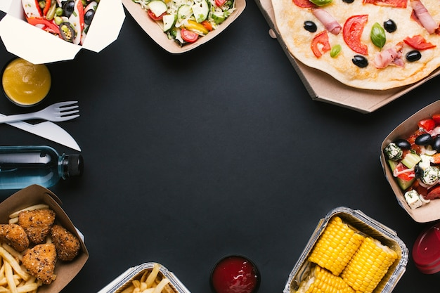 Circular food frame with pizza, salad and corn
