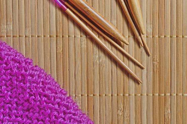Circular knitting needles lie next to the beaches