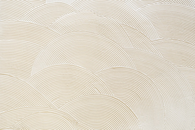Circular patterns on white plaster. abstract texture