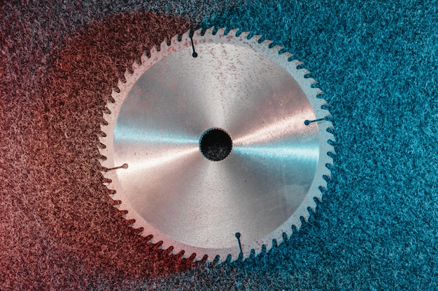 Circular saw blade lies on dark