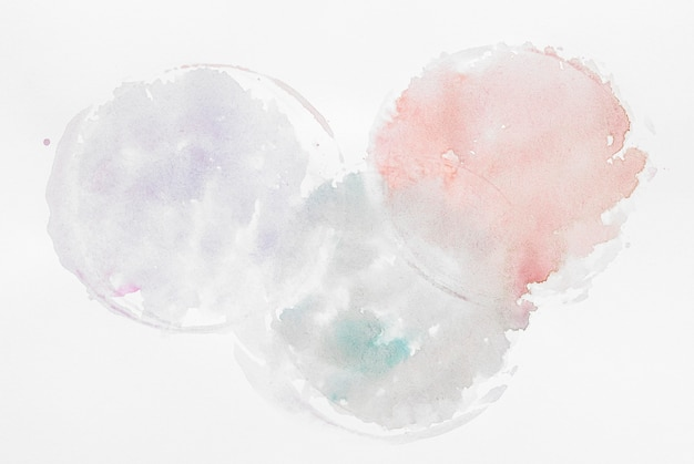 Circular splashes of watercolor paint